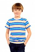 Portrait of a ten years boy smiling at camera. Isolated over white.
