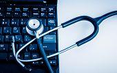Electronic medical, stethoscope on PC/Laptop/Keyboard�?�¯�?�¼? blue toned images.