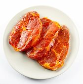 Pork Neck Slices On A Plate