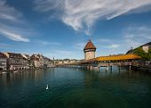 Lucerne, Switzerland - April 20, 2014: A View Of The Famous Wooden Chapel Bridge With The Water Towe