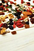Mix Nuts Seeds And Dry Fruits, On A Wooden Table