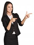 Business girl shows forefinger in the direction.