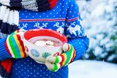 Hands Of Child Holding Big Cup With Snowflakes And Hot Cocoa And Chocolate Drink And Marshmallows. K