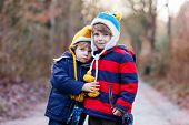 Two Funny Little Kid Sibling Boys Hugging On Cold Day