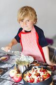 Adorable Little Boy Helping And Baking Apple Pie In Home''s Kitchen