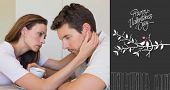 woman consoling a sad man at home against cute valentines message