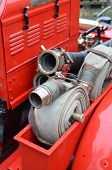 image of fire brigade  - Classic 1960 British fire brigade water hoses on rear of appliance - JPG