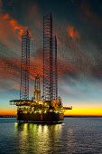 picture of  rig  - Oil drilling rig on sea in sunset time - JPG