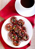 picture of sprinkling  - Mini donuts coated with chocolate and sprinkles with cup of coffee - JPG