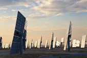 Green Energy Solar Mirror Panels At Sunset Or Sunrise
