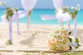beautiful bridal bouquet on wedding arch background, outdoor beach wedding