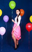Portrait Of A Young Attractive Woman Near Many Bright Balloons