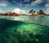 pic of bottom  - Split shot of the sandy bottom with rocks on the coast of Indian Ocean - JPG
