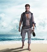 Handsome young pirate on the beach, barefoot