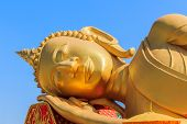 stock photo of recliner  - Image of Reclining Golden Buddha face in the centre of Vientiane Laos - JPG