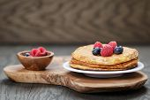 Pancakes With Berries, On Wooden Table