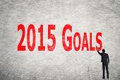 Asian business man write words on wall, 2015 Goals