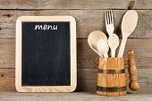 Menu Board And Wooden Spoons And Fork In Mug