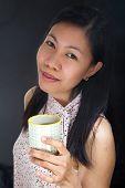 Portrait Of An Asian Girl Drinking Tea