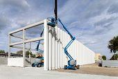 Building under construction. Columns. Cranes