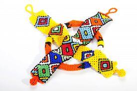 picture of zulu  - two zulu beaded wristbands and orange armband - JPG