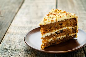 picture of torte  - carrot cake with walnuts prunes and dried apricots on a dark wood background - JPG