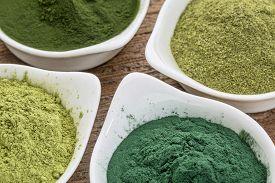 foto of chlorella  - four healthy green dietary supplement powders  - JPG