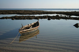 pic of safe haven  - Fisherman Boat docking at a temporary safe haven in the quite water of a small lagoon before the tide comes in - JPG