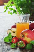 picture of fruit-juice  - fruit juice ripe apples and strawberries on old wooden table - JPG