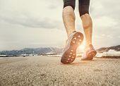 foto of sprinter  - Close up sprinter legs on asphalt  - JPG