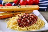foto of baguette  - Spaghetti Bolognese With Garlic Bread Baguettes and on the vine tomatoes - JPG