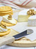 picture of brie cheese  - Soft brie cheese with crackers and nuts - JPG