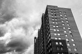 picture of high-rise  - High rise tower block in back and white monochrome with dark storm clouds - JPG