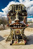 stock photo of scrap-iron  - Welded car scrap metal formed into a human head with eyes and facial features - JPG