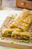 stock photo of chive  - Strudel with spinach blue cheese and garlic sprinkled with chive and sesame - JPG