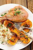 image of butternut  - Roasted turkey leg with butternut squash pumpkin seeds and rice vertical closeup - JPG