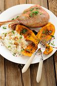 picture of butternut  - Roasted turkey leg with butternut squash pumpkin seeds and rice and two forks vertical - JPG