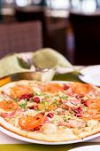 foto of tourist-spot  - Authentic pizza with tomatoes smoked sausage bacon and parsley. Morning atmospheric lighting fashionable trendy spot soft focus. Preparation for design creative menu. ** Note: Visible grain at 100%, best at smaller sizes - JPG