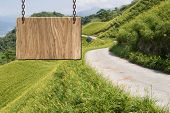 stock photo of tranquil  - Blank wooden sign on field of farm - JPG
