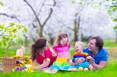 stock photo of healthy eating girl  - Young family with kids having picnic outdoors - JPG