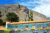 stock photo of hacienda  - Old colonial building with hills rising high above in Tarma Peru - JPG