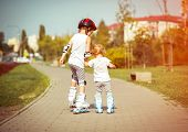 foto of little sister  - two little sisters to roller skate on the street - JPG