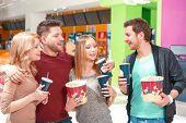 Постер, плакат: People waiting for movie with snacks