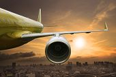 picture of jet  - passenger jet plane flying above urban scene use for aircraft transportation and traveling business background - JPG