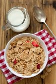 image of cereal bowl  - cereals with dry fruits in white bowl milk and spoon - JPG