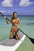 girl in bikini on a paddle board