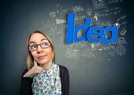 picture of nerds  - Thinking student nerd with idea - JPG