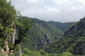 stock photo of ravines  - Ravine and mountains up in the North of Greece  - JPG