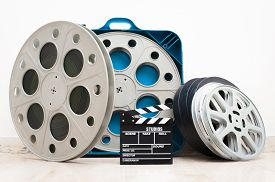 picture of mm  - Movie clapper board and 35 mm cinema reels with film and blue box - JPG