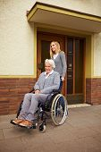 Elderly Woman In Front Of Retirement Home